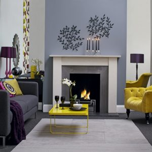 Corporate Housing - Spaciouse, yellow sofa, grey wall with house burning fireplace. Simply beautiful