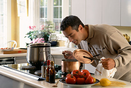 Self-Catering Accommodation - Man Cooking